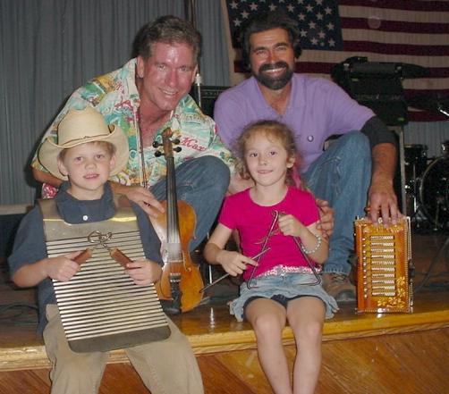 Dennis, Paul Daigle, our grand daughter, and other child at a CFMA dance.
